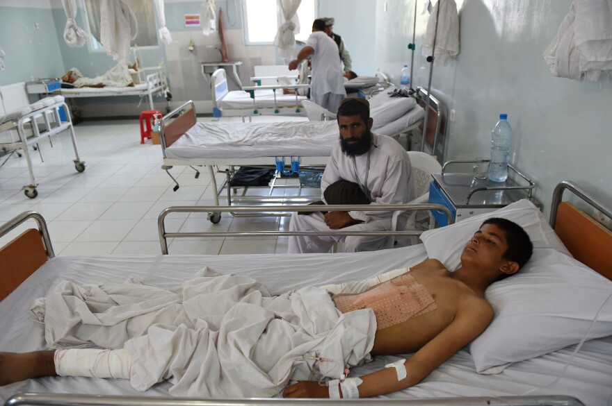 On May 21, an Afghan child is treated at a Doctors Without Borders hospital in the northern city of Kunduz, after being injured in a fight between the Taliban and Afghan security forces.