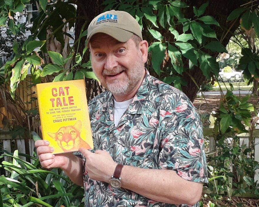 PIttman holds book