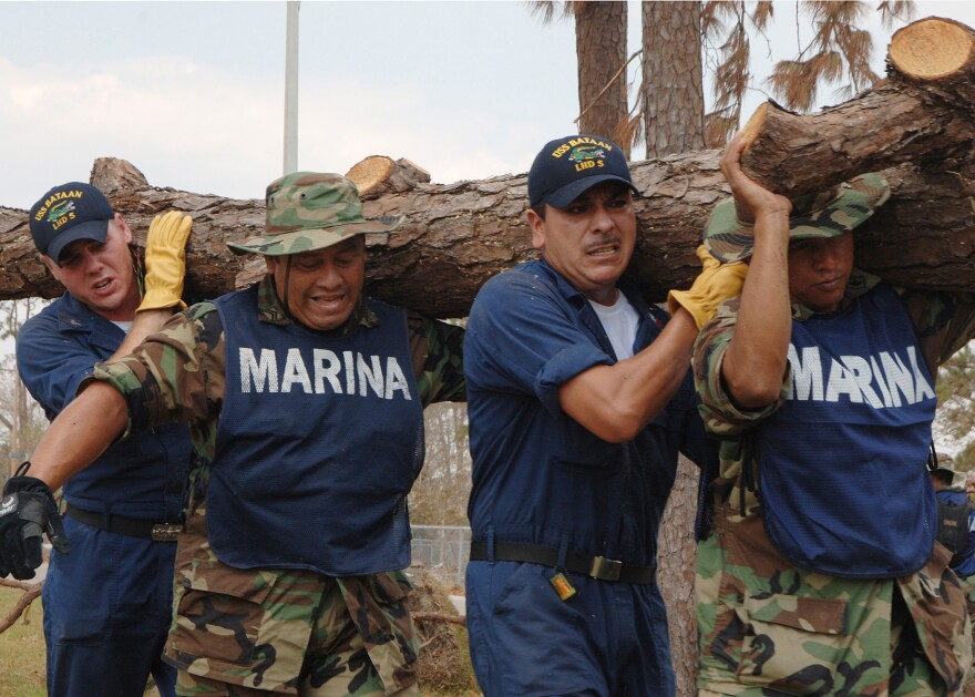 U.S._Navy_sailors_and_Mexican_marines_cleaning_up_hurricane_debris.jpg