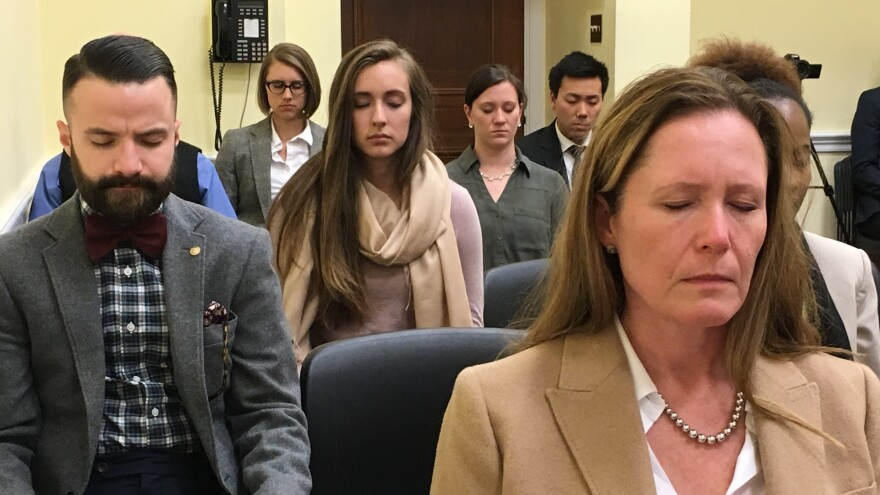 Capitol Hill staffers meditate.