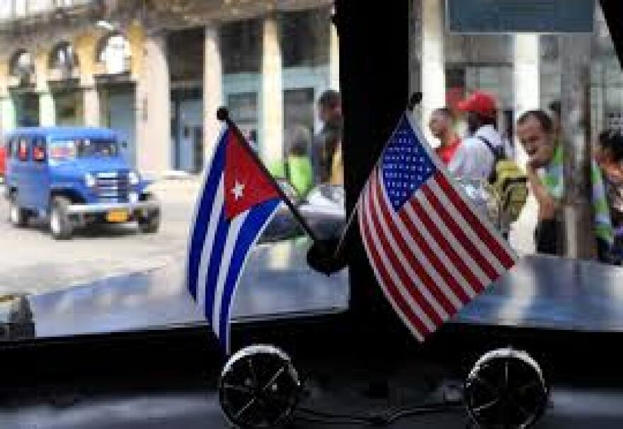 A car in Havana sports Cuban and U.S. flags in advance of talks there to normalize relations between the two countries.