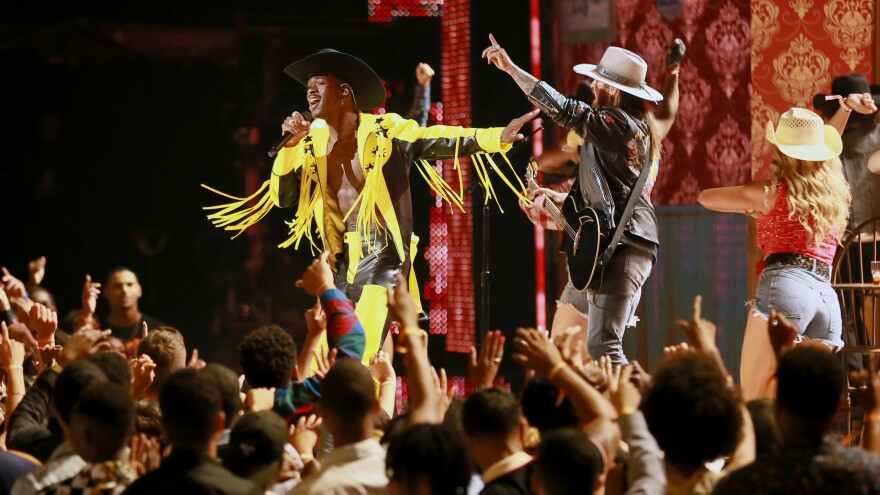 Lil Nas X and Billy Ray Cyrus perform onstage at the 2019 BET Awards.