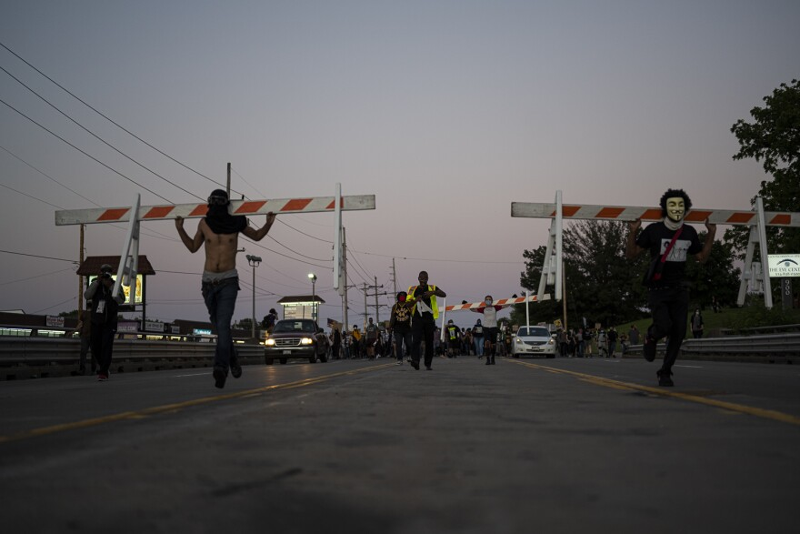Protestors marched down Lindbergh Blvd. well into the evening, moving traffic blockades to shut down intersections.