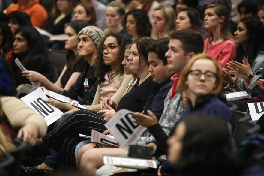 UT Austin students attend a town hall meeting on faculty sexual misconduct, in January.