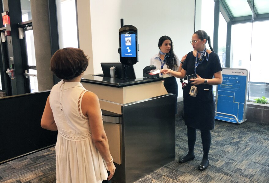 A passenger boarding a Copa Airlines flight at Tampa International Airport using the new biometric face scanner.