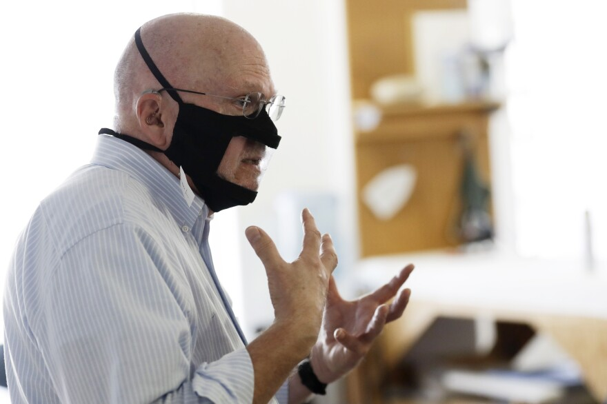 Michael Conley, who is deaf, models a mask that has a transparent panel in San Diego on June 3. Face coverings can make communication harder for people who rely on reading lips, and that has spurred a slew of startups and volunteers to make masks with plastic windows.