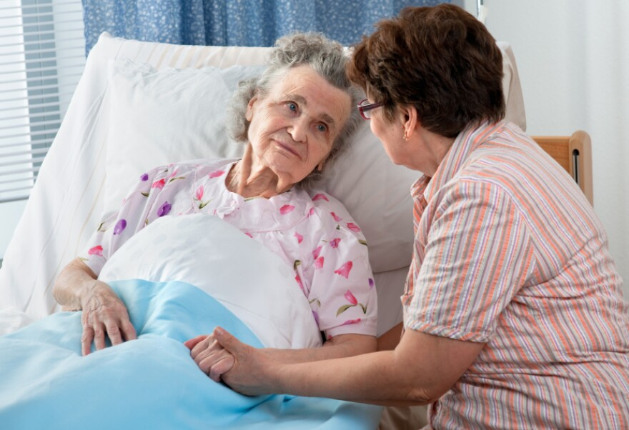 stock_elderly_patient_and_woman.jpg
