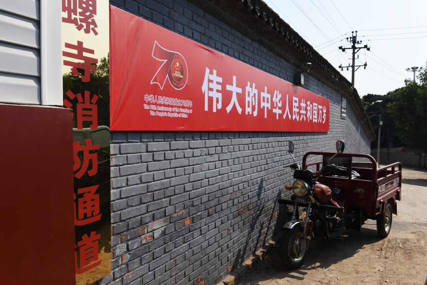 Banners, signs and giant floral arrangements have gone up all over Beijing to celebrate the 70th anniversary of the founding of modern China.