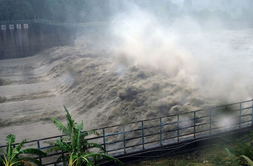 Waters churned in the Jhihtan Dam in Xindian district, New Taipei City, as Typhoon Megi hit eastern Taiwan.