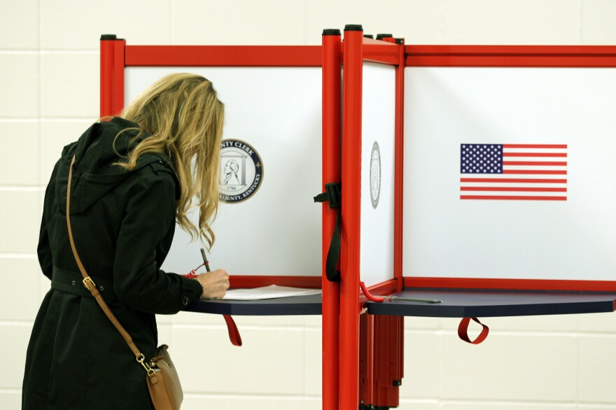 A voter casts a ballot in Louisville, Ky., this month. Long-serving election officials around the country are retiring ahead of the 2020 election, which could be among the most challenging to administer in the country's history.