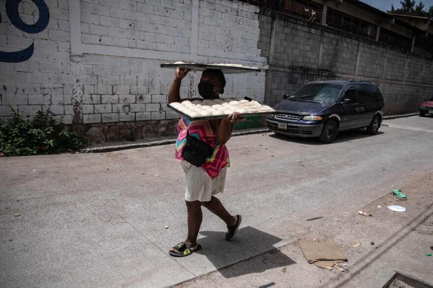 Along with other members of the Garifuna diaspora in the downtown capital district, Ella baked sheets of coconut bread every day at a community oven a block over from her home as the household's primary source of income.