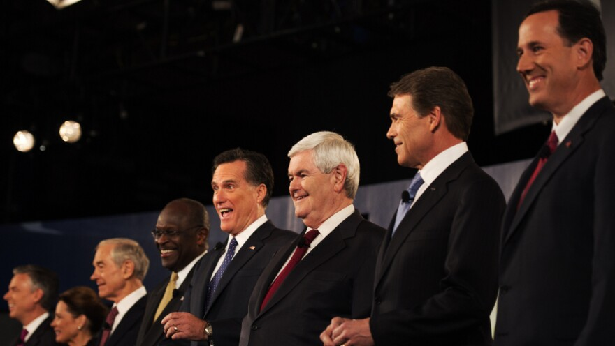 """Rick Santorum (right) was put on one end of the candidates, Jon Huntsman (far left) on the other during a Nov. 12 televised debate in South Carolina. During the debate, Huntsman complained about being """"a little lonely over here in Siberia,"""" and Santorum responded: """"Tell me about it."""""""
