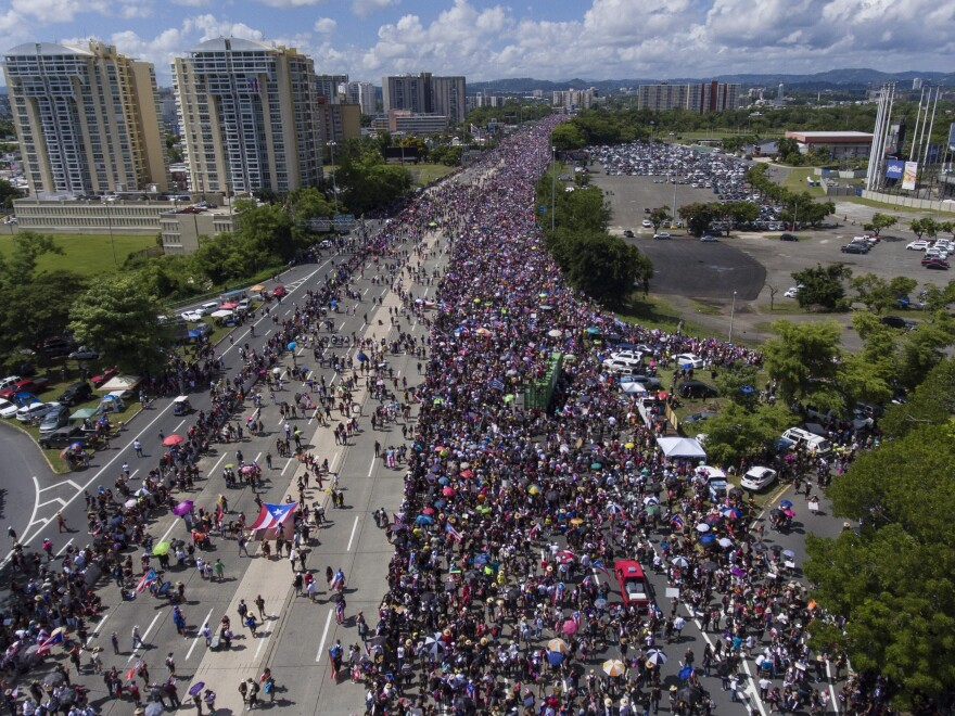 Demonstrators march on Las Americas highway demanding the resignation of the governor in San Juan, Puerto Rico, on Monday.