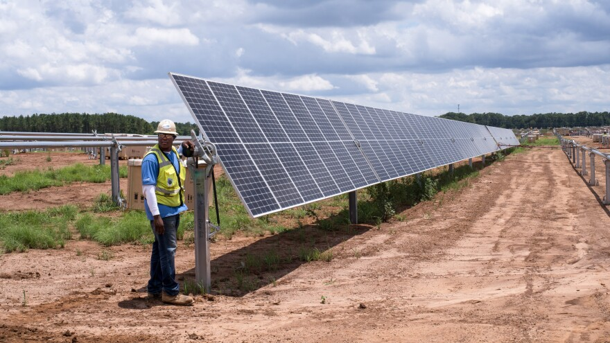 A row of solar panels is installed at Silicon Ranch's latest project outside Blakely, Ga. This 102.5-megawatt power plant will generate electricity for Facebook's new data center in Newton County, Ga., 200 miles away.