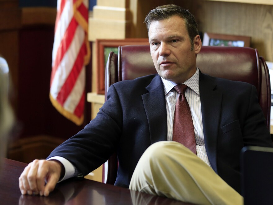 Kansas Secretary of State Kris Kobach talks with a reporter in his office in Topeka, Kan., in May of this year, after he was appointed by President Trump to co-chair the Presidential Commission on Election Integrity.