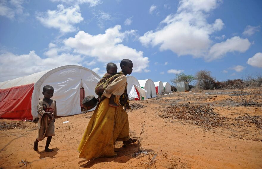 Somali children walk to a food distribution on the outskirts of Mogadishu on April 9.
