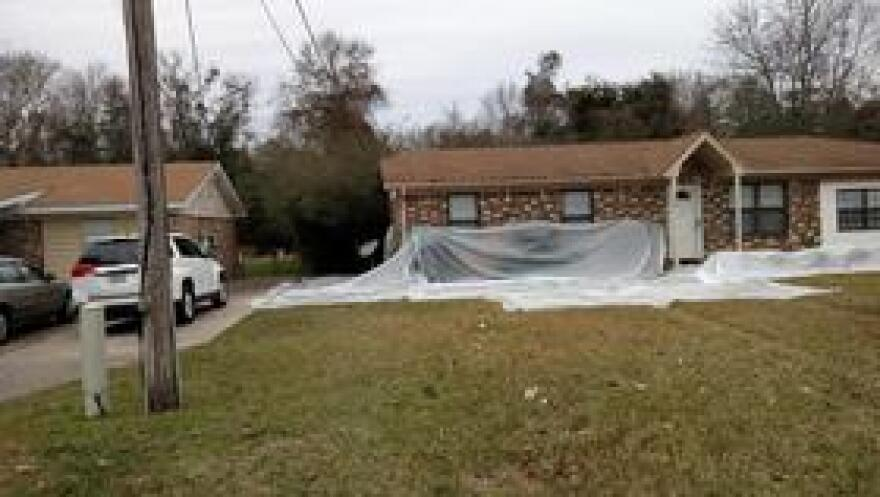 Plastic has been laid around this home in the Woodbury Circle neighborhood in preparation for remediation.