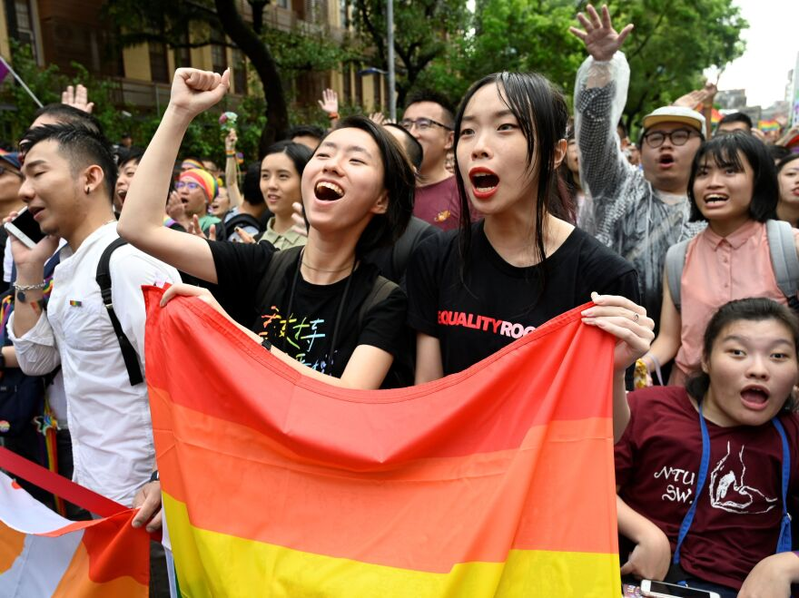 In a landmark first for Asia, Taiwan has legalized same-sex marriage. Supporters celebrate the bill's passage outside parliament in Taipei on Friday.