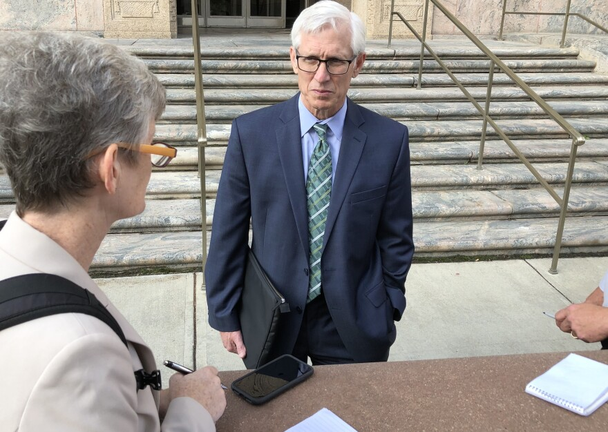 Gene Pierce, Ohioans Against Corporate Bailouts, talks to journalists outside of the federal courthouse in downtown Columbus.