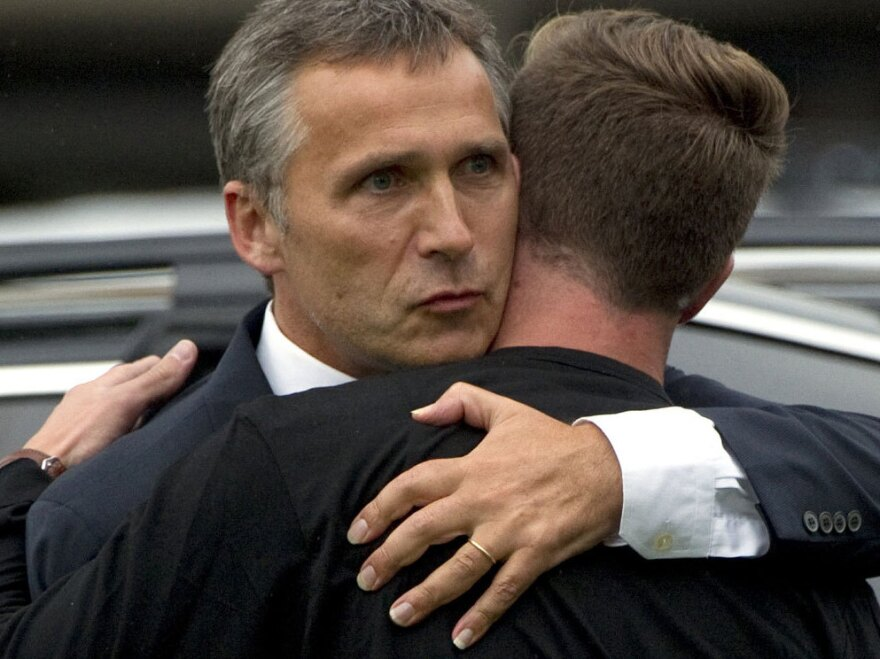 Norwegian Prime Minister Jens Stoltenberg (left) embraces  Eskil Pedersen, the leader of the Norwegian Labour Youth league and  survivor of the Utoya island shooting, at a hotel where survivors of  the youth camp attack are being reunited with their families in  Sundvolden.