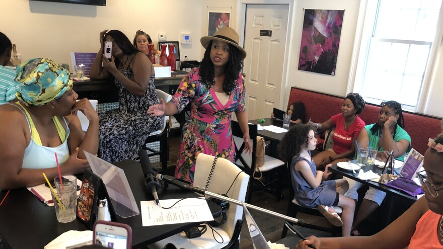 Ayanna Pressley talks to constituents on the campaign trail. Pressley is challenging a 10-term incumbent in the Massachusetts' 7th Congressional District Democratic primary.