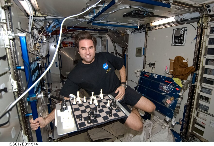 Greg Chamitoff plays chess in the Harmony Node of the International Space Station on July 19, 2008.