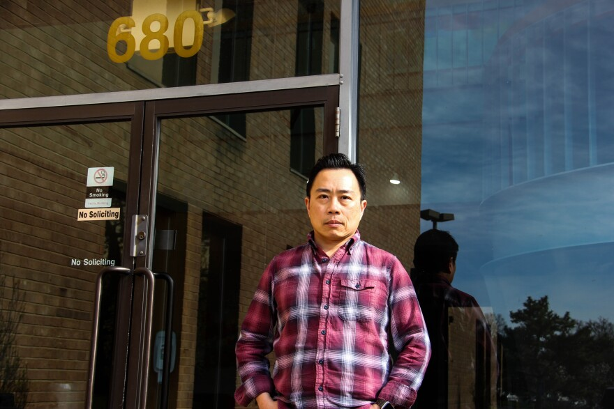 VOYCE program director Chien Hung standing outside of his office building on March 30, 2020.