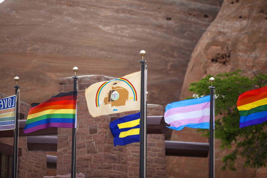 The Navajo Nation flag flies alongside LGBT and human rights flags in a historic first outside the Navajo Nation Council Chamber in Window Rock.