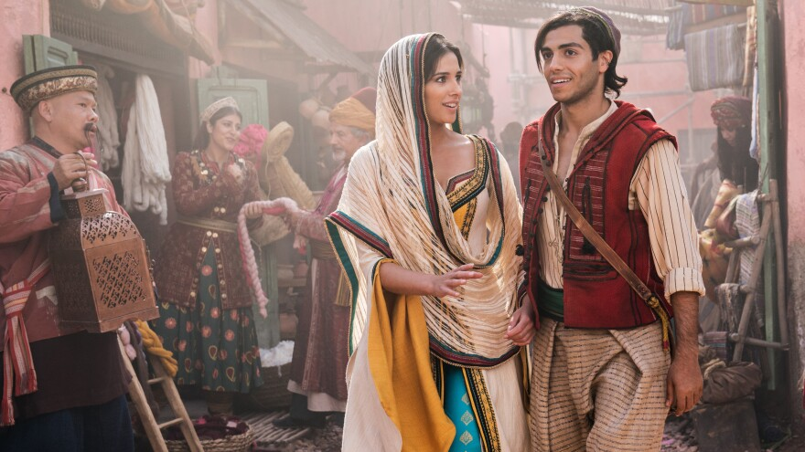 Naomi Scott stars as Jasmine and Mena Massoud as Aladdin in Disney's live-action adaptation of Aladdin.