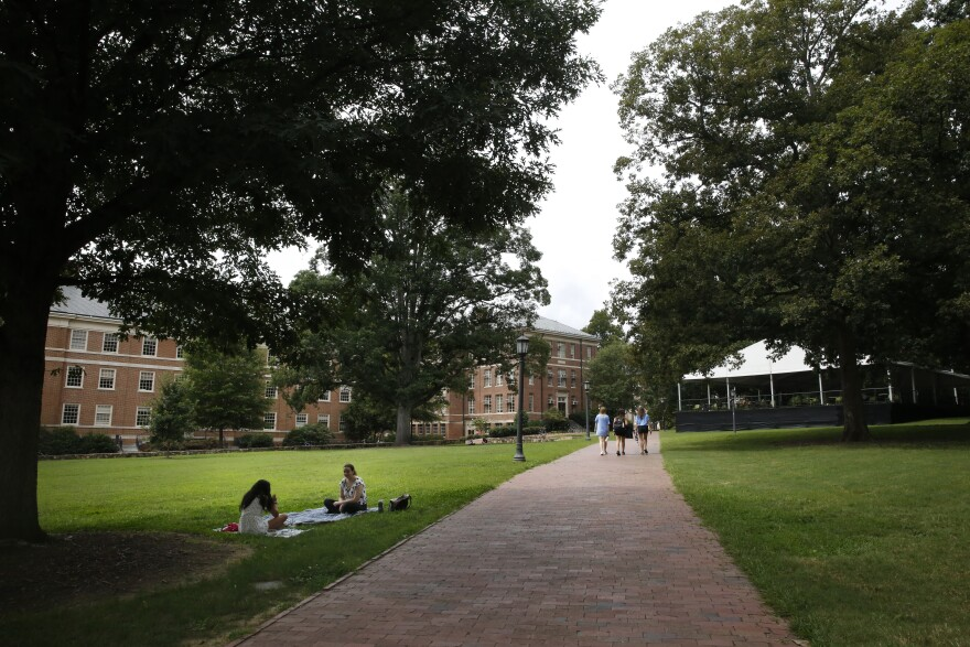 Students lounge on campus at the University of North Carolina at Chapel Hill. The university reported its first coronavirus clusters after a week of in-person classes.