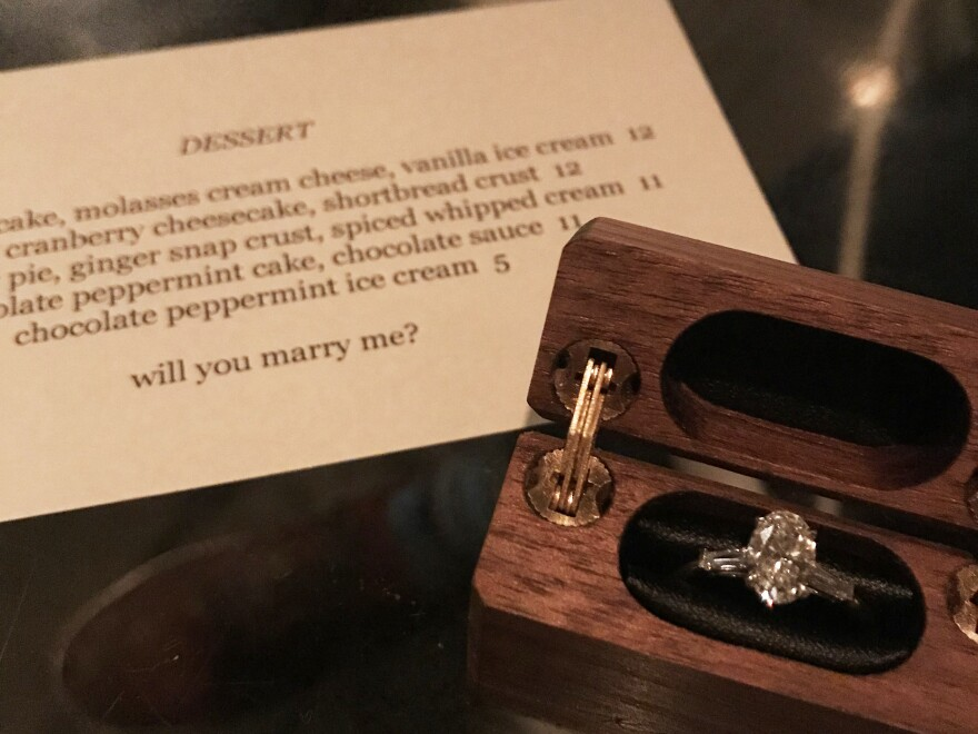 Kevin Biely proposed to Kat McClain over dessert a year to the day of their first date.