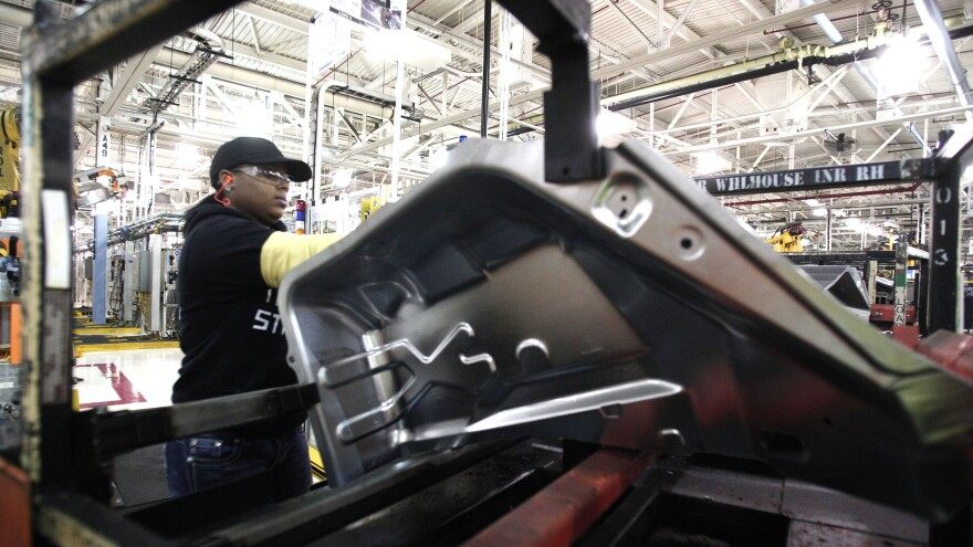 A worker is shown last month at the Fiat Chrysler Automobiles Warren Stamping Plant in Warren, Mich.