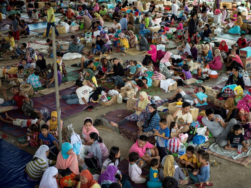 Evacuees from Marawi gather in nearby Lanao del Sur on Monday. Up to 2,000 civilians reportedly remain trapped in Marawi, caught in fighting between government forces and militants.