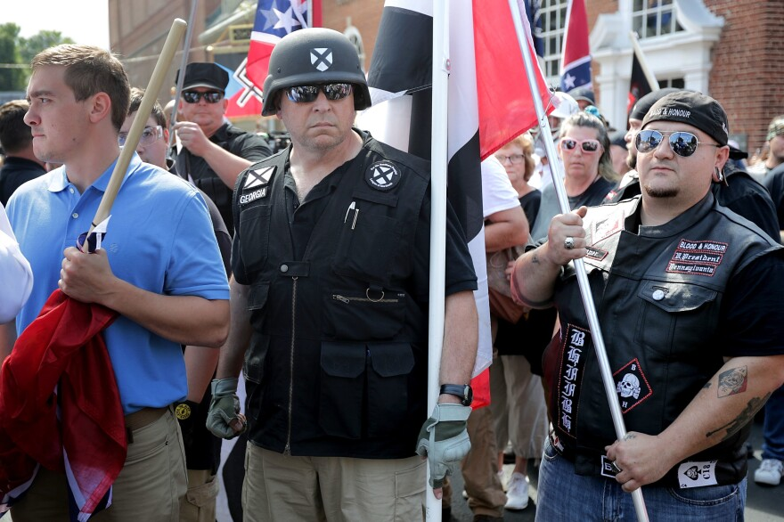"""Hundreds of white nationalists, neo-Nazis and members of the """"alt-right"""" march toward Emancipation Park during the """"Unite the Right"""" rally on Aug. 12 in Charlottesville, Va."""