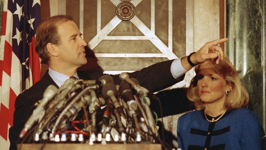 Biden gestures during a Sept. 23, 1987, news conference to announce his decision to withdraw as a candidate for the 1988 Democratic presidential nomination. With him is his wife Jill.