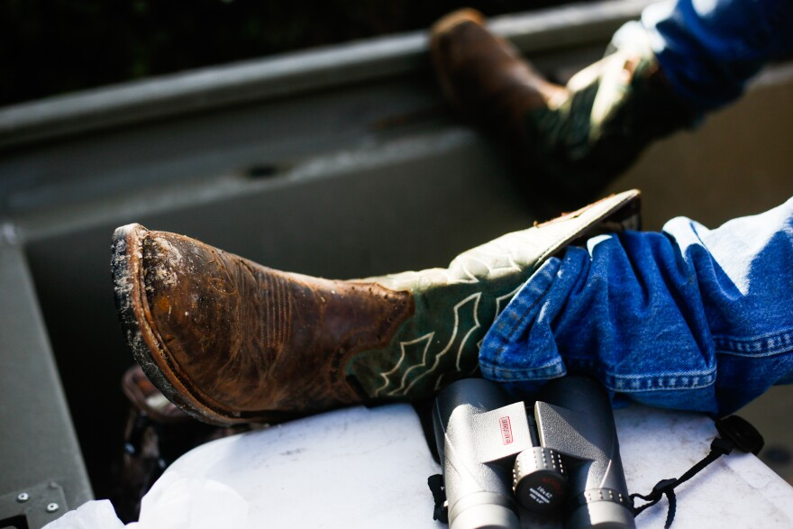 Richie Smith props up his leg next to his binoculars while hunting on October 26, 2019.