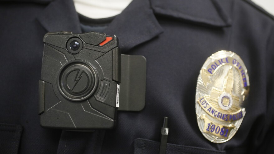 Many residents of Ferguson, Mo., would like to see the police wear video cameras, like this one worn by a Los Angeles police officer.