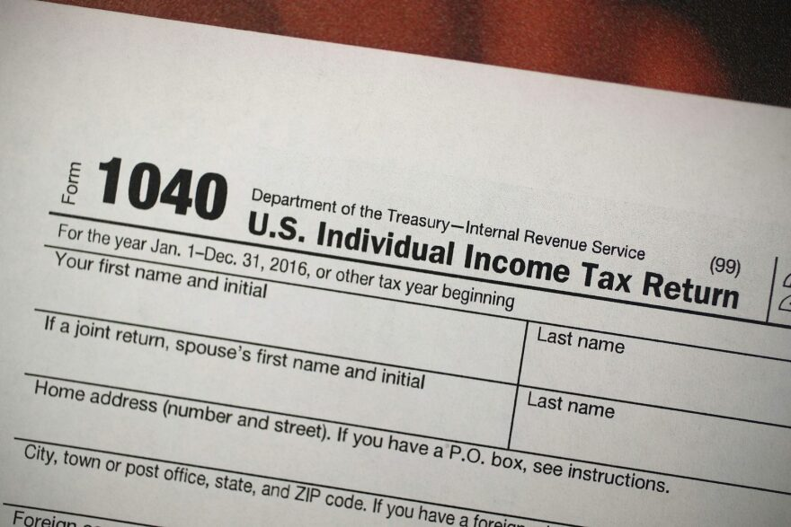 A copy of an IRS 1040 tax form is seen at an H&R Block office.