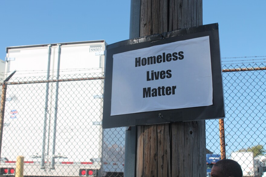 Sign at a homeless tent encampment on sidewalk in downtown St. Louis on Oct. 26, 2017.
