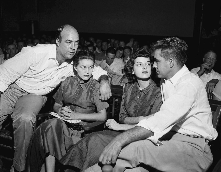 Emmett Till's killers J.W. Milam (left) and Roy Bryant sit with their wives, Juanita Milam (second from left) and Carolyn  Bryant, in September 1955. The two men attacked the teen after Carolyn Bryant claimed he made an aggressive pass at her.