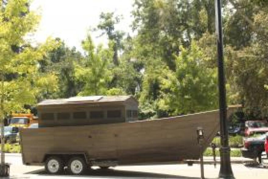 """The ark is parked on Gaines Street in Tallahassee. The NextGen """"Ark Tour"""" narrative imagines a world in which Gov. Rick Scott builds an ark instead of fighting climate change."""