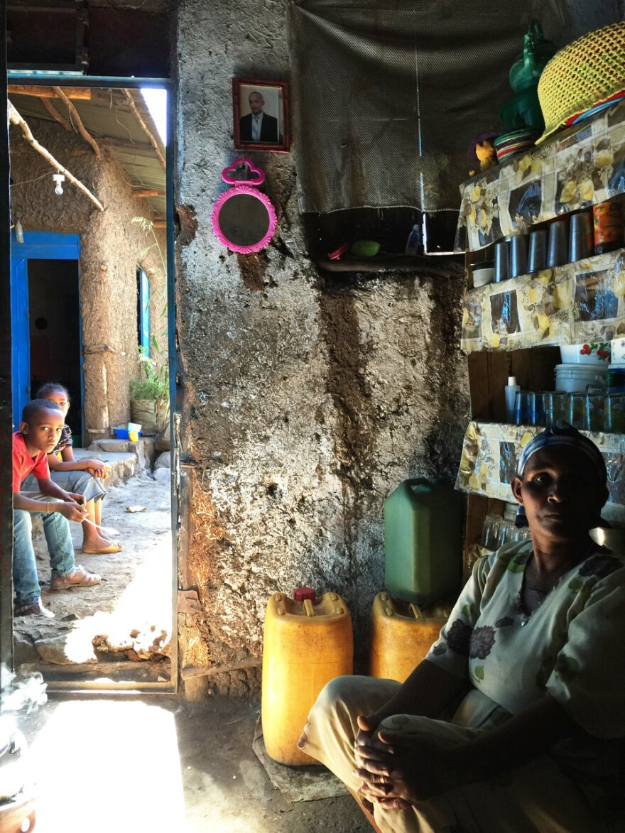 Gezahegn Derebe's mother, Ayelesh is shown here in their home in Gondar. On the wall behind her hangs a framed photograph of her twin brother, Tachelo, who was allowed to emigrate to Israel in 2003.