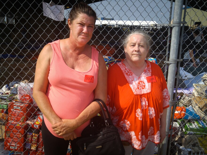 Judy Reed (right) came to the shelter searching for her black Great Dane, Shadow, with her friend, Evelyn Richard. Rescuers came to Reed's home outside Beaumont, Texas, by boat during the storm, and she had to leave Shadow behind.