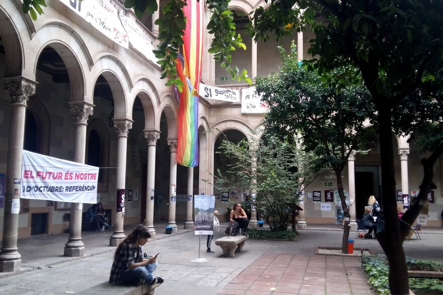 """A banner hangs in the courtyard of a University of Barcelona building that reads, """"The future is ours,"""" in Catalan. Students are """"occupying"""" the building ahead of an independence vote."""