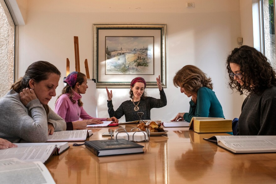 Michelle Farber (center) leads a daily Talmud class for women.