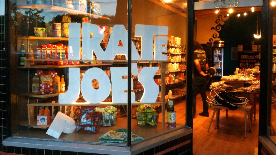 """""""I bought the stuff at full retail. I own it,"""" says Michael Hallatt, owner of the _irate Joe's grocery in Vancouver. His store faces a lawsuit from Trader Joe's for infringing on its trademark and possibly confusing customers."""