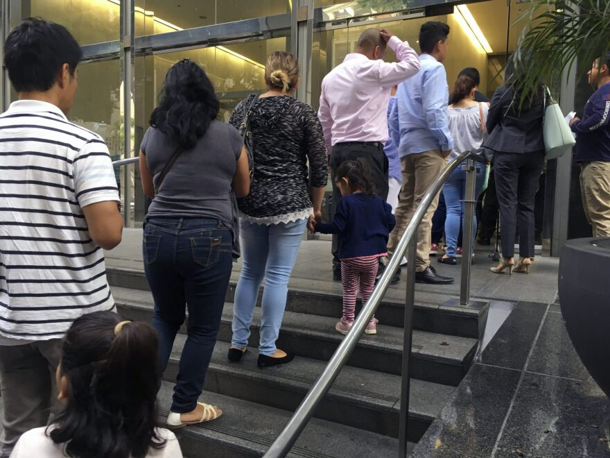 In this June 28, 2018, photo, people line up outside the building that houses the immigration courts in Los Angeles. In recent weeks, immigration judges have been thrust into the center of the heated political controversy over how the Trump administration is handling the cases of mostly Central American immigrants caught on southwest border. (Amy Taxin/AP)