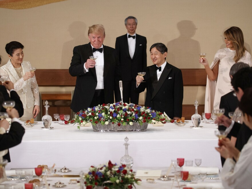 President Trump and First Lady Melania Trump attend a state banquet with Japanese Emperor Naruhito (second from right), and Empress Masako (left) on Monday in Tokyo.