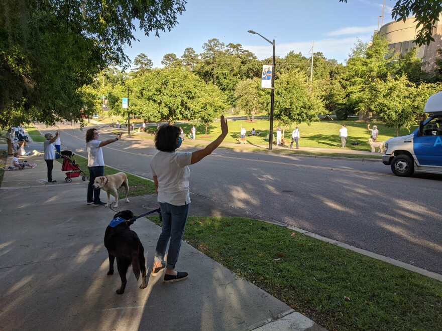Therapy dogs and their handlers greet incoming and outgoing hospital staff - especially nurses - during Wednesday evening's Tallahassee Memorial shift change.