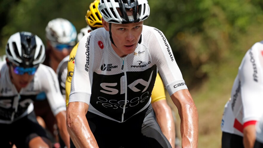 Chris Froome, the defending champion at the Tour de France, has fallen to third place. Along the way, he's been grabbed off his bike by police and struggled to match his top competitors.